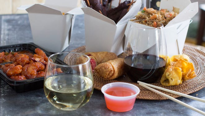 Pairing wine and Chinese takeout food in Concord, N.H. on Jan. 5, 2015. The bold flavors of Chinese takeout require an equally bold spirit to commend wine pairings.