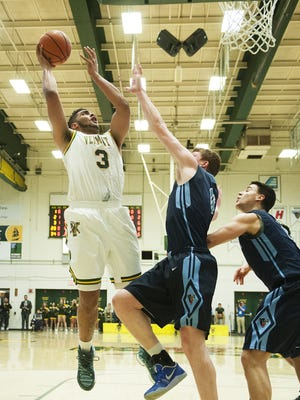 Vermont's Anthony Lamb (3) leaps to take a shot during the men's basketball game between the Maine Black Bears and the Vermont Catamounts at Patrick Gym on Wednesday night.