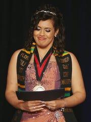 Gateway Charter School student Alexandra Lozano accepts
