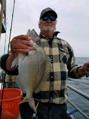 Jim Holberg, Toms River, with a porgy he landed on the Dauntless party boat.