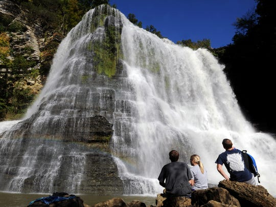 Hikers sit at the base of Burgess Falls in Sparta,