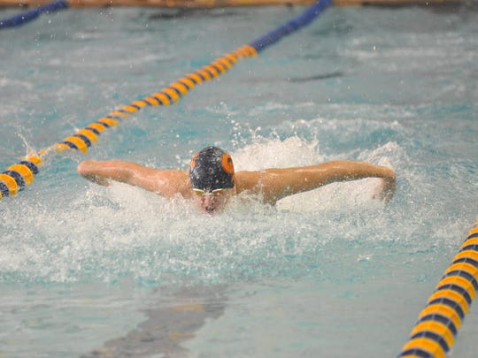 Galion's Clay Karnes swims the 100 butterfly.