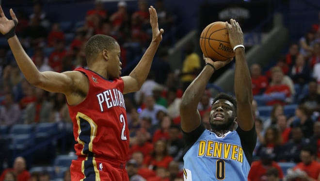 Denver Nuggets guard Emmanuel Mudiay (0) takes a shot while defended by New Orleans Pelicans guard Tim Frazier (2) at the Smoothie King Center on Wednesday. Even with Mudiay, the Nuggets lack a clutch player, columnist Mark Knudson says.