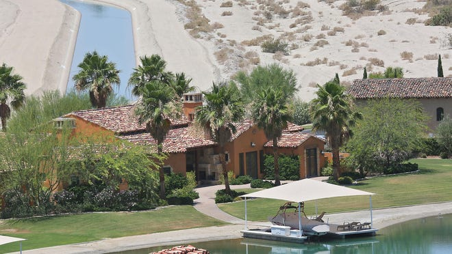 A home on the water at Shadow Lakes Estates in Indio is seen on June 1, 2015. At top left is the Coachella Canal, which brings Colorado River water to the valley.