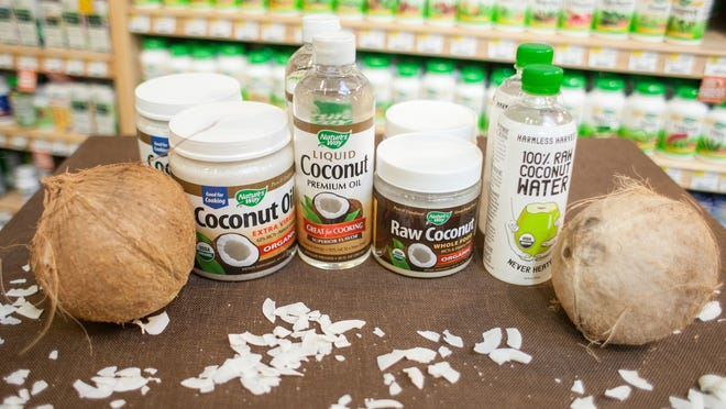 A display of coconut products are set out for sale at Whole Foods. March 26, 2013