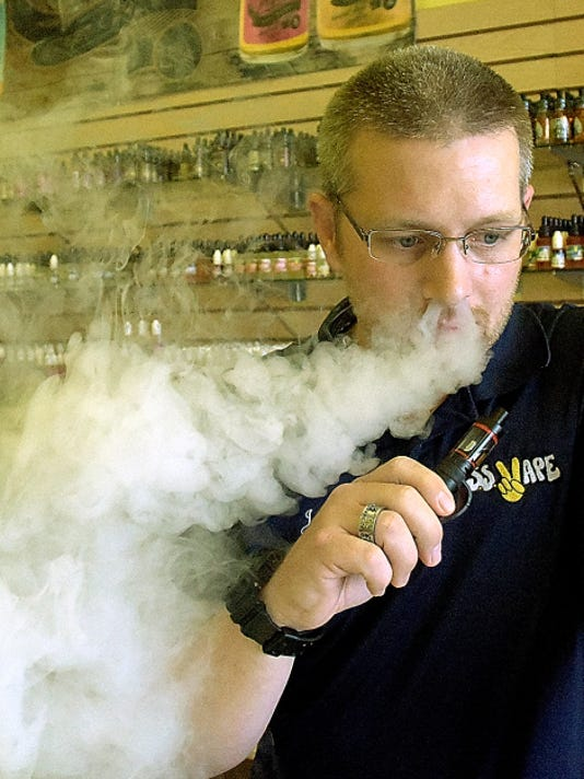 Jason Goin, district manager for SS Vape at Manchester Crossroads shopping center,  says vaping helped him quit smoking. The federal government is considering regulations to tighten oversight on the growing e-cigarette industry.