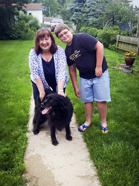 """This photo of Walker Shepps, 13, meeting Bella and her mom, Judy Hummel, for the first time was submitted to the Lebanon Daily News by Michelle Shepps for our Community Journalism photo collection this summer. This photo's theme was """"Dog Days of Summer."""" This week we are collecting photos on our Facebook page (www.Facebook.com/ldnews) or on Instagram (@lebdailynews) to fit the theme """"The Purrrrfect Summer."""" Photos chosen from those submissions will be published next week and all photos submitted go on our Pinterest page."""