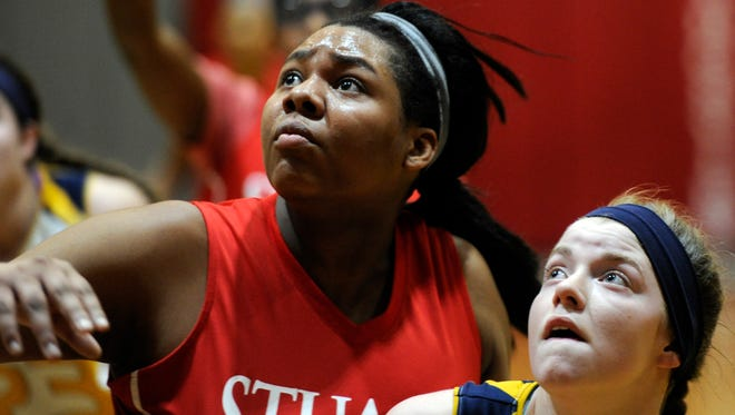 Stuart Hall's Camille Horton,#30 and Timberlake's Jullian Finnerty, #5 watch for a rebound in the third quarter in the VACA championship game Saturday. Stuart Hall vs. Timberlake Christian girls  high school basketball, Feb. 27, 2016.