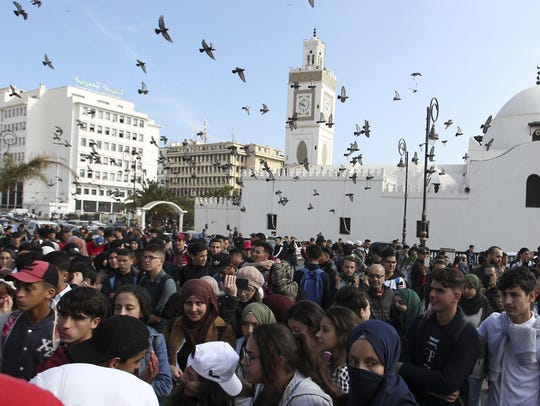High school students march in central Algiers, Sunday,