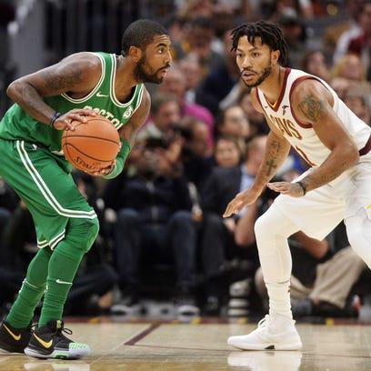 Boston Celtics guard Kyrie Irving (11) works against