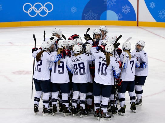 Players from the United States celebrate after the preliminary round of the women's hockey game against Finland at the 2018 Winter Olympics in Gangneung, South Korea, Sunday, Feb. 11, 2018. The United States win 3-1. (AP Photo/Frank Franklin II)