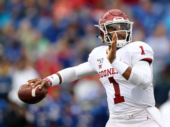 LAWRENCE, KANSAS - OCTOBER 05:  Quarterback Jalen Hurts #1 of the Oklahoma Sooners passes during the game against the Kansas Jayhawks at Memorial Stadium on October 05, 2019 in Lawrence, Kansas. (Photo by Jamie Squire/Getty Images)