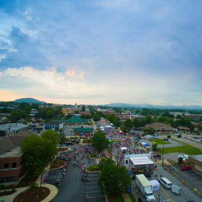 Visitors cram downtown Hendersonville during a street festival.