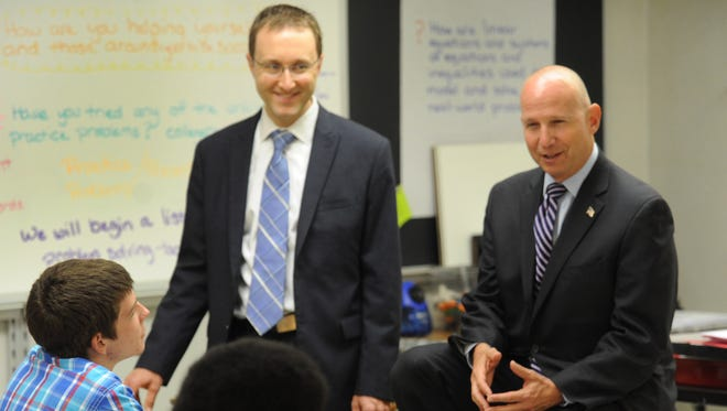 Gov. Jack Markell (right) and State Secretary of Education Mark Murphy talk with students at Laurel High School. A new report says half of Delaware students need remedial classes when they start college, which is causing drop outs and late graduations.