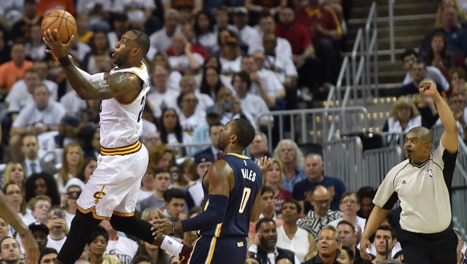 Apr 15, 2017; Cleveland, OH, USA; Cleveland Cavaliers forward LeBron James (23) is fouled by Indiana Pacers forward CJ Miles (0) in the second quarter in game one of the first round of the 2017 NBA Playoffs at Quicken Loans Arena. Mandatory Credit: David Richard-USA TODAY Sports