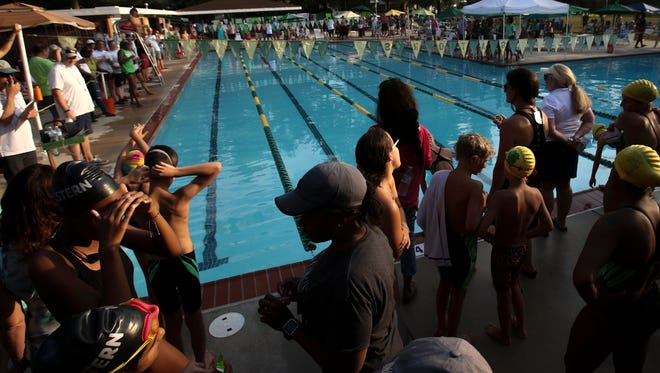 Swimmers get set in the starting area at Nottingham Swim Club in Newark as the home team hosts the Western Y as the Suburban Swim League heads for the end of swim season championships.