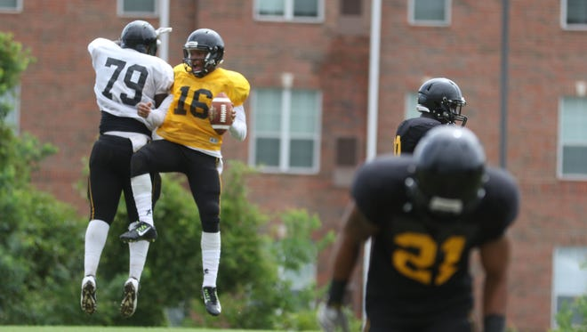 William Jefferson (79) and Charles Wright (16) celebrate after scoring a touchdown during a scrimmage at Grambling's practice last Saturday. The Tigers' scrimmage Saturday was cancelled due to weather.