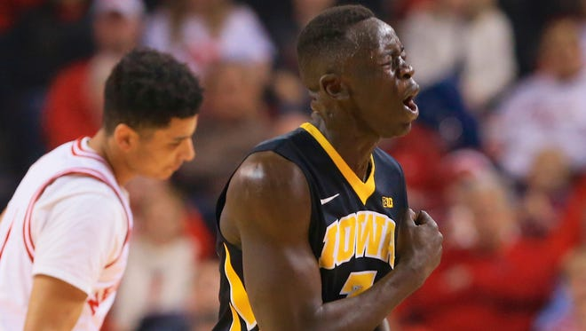 Iowa's Peter Jok (3) reacts after hitting a 3-point basket as Nebraska's Tai Webster, left, looks on during the first half of an NCAA college basketball game in Lincoln, Neb., Sunday, Feb. 22, 2015. (AP Photo/Nati Harnik)