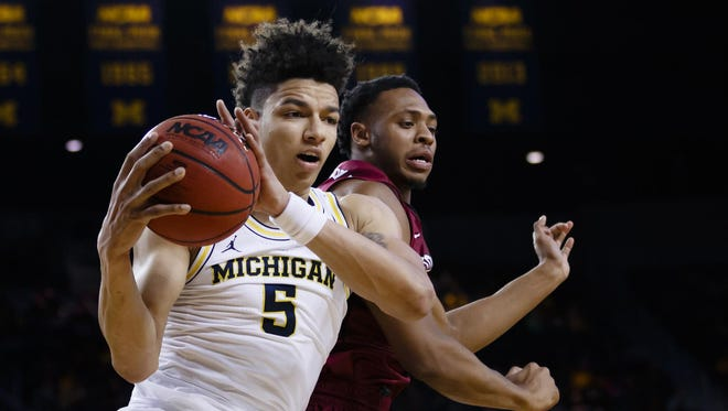 Michigan Wolverines forward D.J. Wilson grabs one of his 14 rebounds against IUPUI on Sunday, Nov. 13 at Crisler Center.
