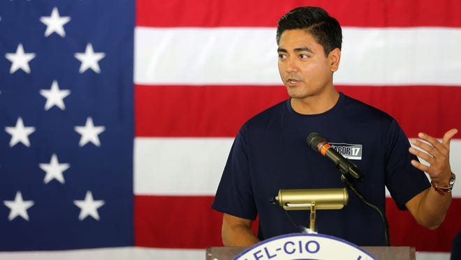 Hamilton County Clerk of Courts Aftab Pureval speaks during the 2017 Cincinnati AFL-CIO Labor Day Picnic, Monday, Sept. 4, 2017, at Coney Island.