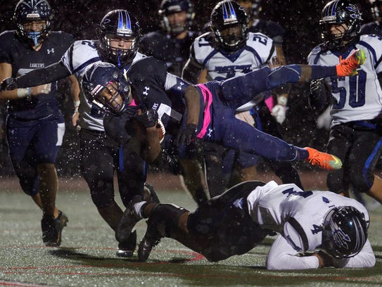 Eastridge's Rayshauid Smith is upended by Brockport's