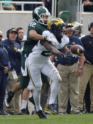 U-M cornerback Jourdan Lewis intercepts a pass intended for MSU's R.J. Shelton during the Wolverines' 32-23 win Saturday in East Lansing.