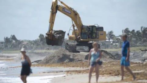 Ferreira Construction crews work on renourishing Bathtub Reef Beach on April 20, 2017, at the beach on South Hutchinson Island.