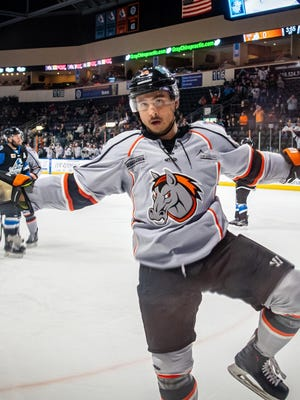 Kansas City Mavericks forward Loren Ulett celebrates after scoring a goal in a game last November. The left wing, who had 10 goals and eight assists in 55 games for the Mavericks last season, re-signed with the ECHL team Tuesday.