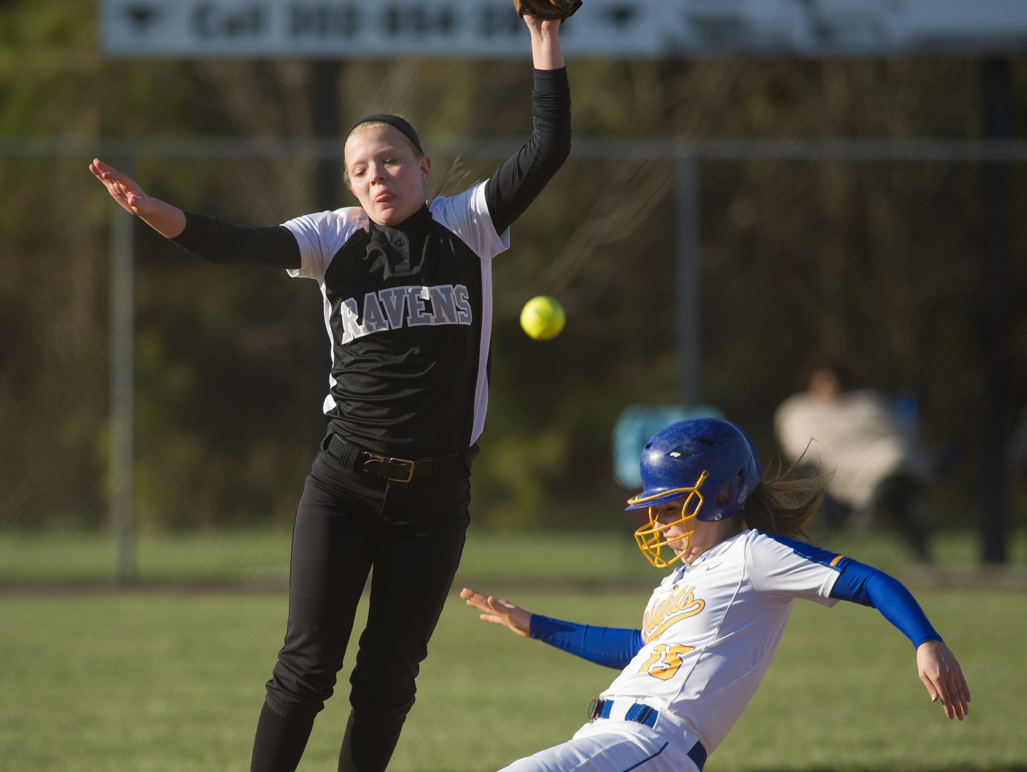 Sussex Tech's Nicole Hovatter (2), left misses a throw to third base letting Sussex Central's Brooke Stoeckel (15) slide in safe.