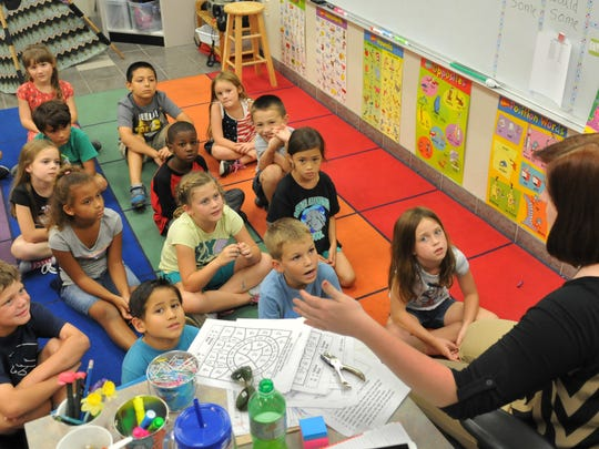 First year teacher Taylor Chang teaches a first grade class at Manatee elementary school in Viera.