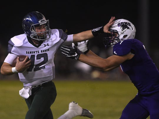 Damonte Ranch's Cade McNamara (12) runs free while taking on Spanish Springs during their football game at Spanish Springs on Sept. 15. Douglas is at Damonte on Friday.