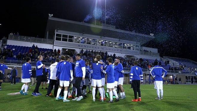 UK celebrates Saturday night's win over FIU, which clinched the Conference USA regular season championship.