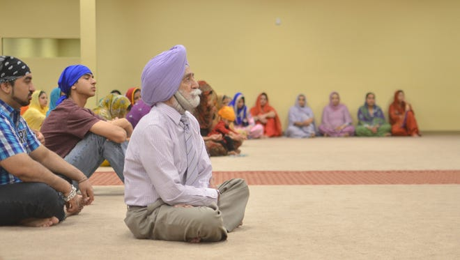 Sikhs participate in a Sunday service at the Reno-Tahoe Sikh Gurughar Temple.