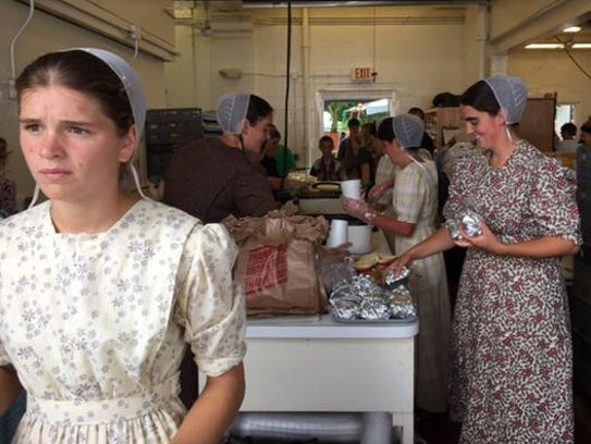 Volunteers serve up roast beef sandwiches at the Shiloh