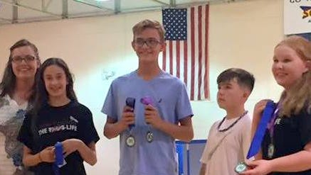 Member of the Luna County 4-H accept awards during the Southwest District competition held in Socorro County.