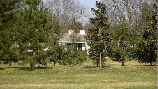 This home at 6210 Harding Pike is one of four rental homes on the nearly 14 acres eyed for a 26-home development.