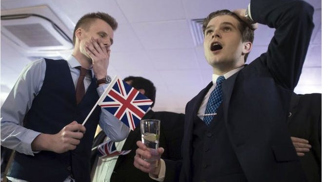 Supporters of leaving the EU celebrate at a party hosted by Leave.EU in central London as they watch results.