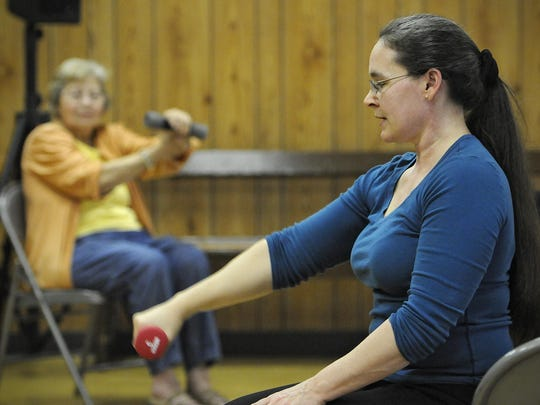 Lorene Deford leads a senior exercise class May 6 in St. Stephen. Helping Hands Outreach expanded into St. Stephen and Opole two years ago.
