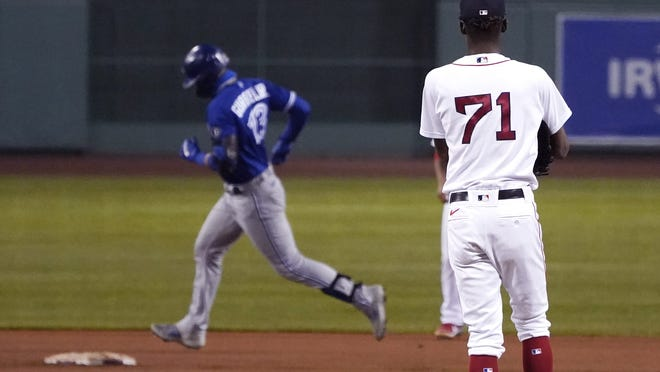 Boston Red Sox relief pitcher Phillips Valdez (71) waits as Toronto Blue Jays' Lourdes Gurriel Jr. runs the bases on a solo home run during the 10th inning of a baseball game Thursday Sept. 3, 2020, in Boston.