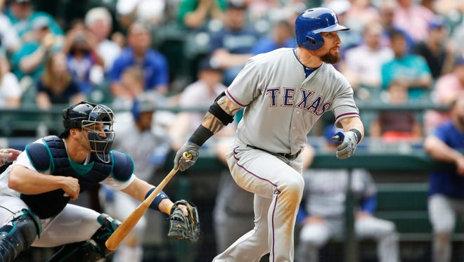 Texas Rangers right fielder Josh Hamilton watches as his RBI single in the 11th inning breaks up a 3-3 tie with the Seattle Mariners