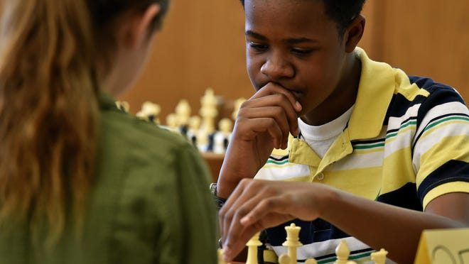 Olde Towne Middle School 6th-grader Kamden Love, 11, competes Friday during the Madison County Pathways District Chess Tournament at Madison Middle School.