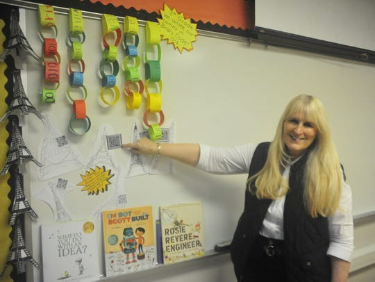 Michelle Vance points to a QR code one of her gifted