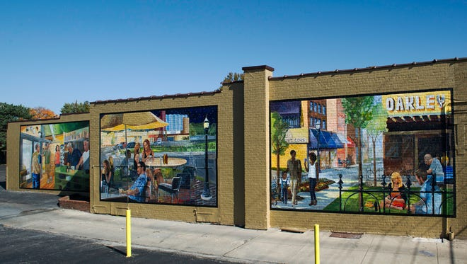 "ArtWorks mural in Oakley entitled ""Morning, Noon, and Night"" was recently vandalized. Photo taken before vandalism."
