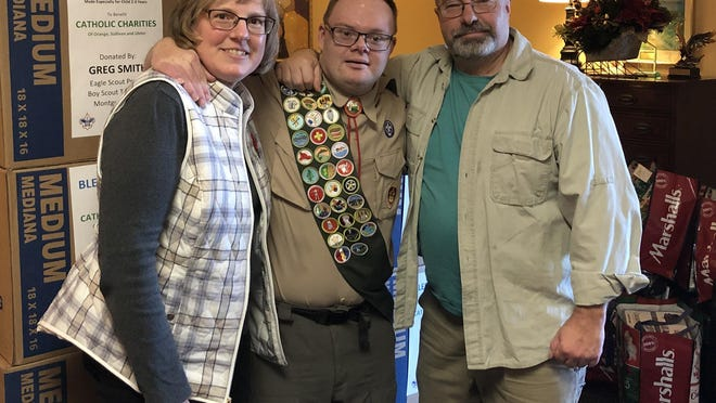 Montgomery Boy Scout, Greg Smith, a member of Troop 386, selected Catholic Charities to be the beneficiary of his Eagle Scout project. He is pictured with his parents, Heidi and Rick, delivering the 210 'blessing' bags that were prepared for Catholic Charities.