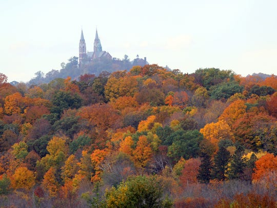 A canopy of colorful leaves decorate the trees near The Basilica of the National Shrine of Mary, Help of Christians, at Holy Hill.