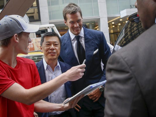 New England Patriots quarterback Brady arrives at NFL headquarters as people ask for autographs in New York