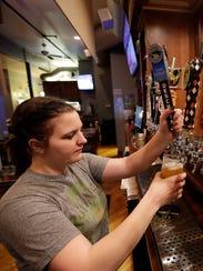Bartender Alexis Johnson draws a Deschutes beer for