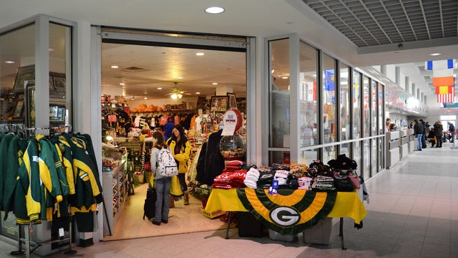 Visitors to Green Bay this weekend will be in the presence of all things Packers as area businesses hope to profit from the NFL divisional playoff game at Lambeau Field. The Airport Gift Shop at Austin Straubel International Airport displays some of its Packers merchandise.