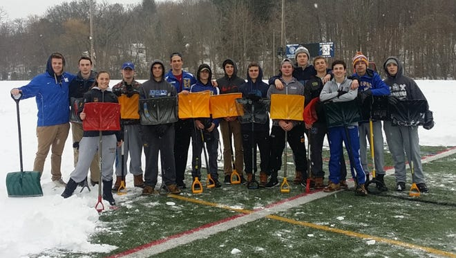 Members of the Mahopac boys lacrosse team spent part of the weekend shoveling the school's field, hoping to get outside for practice this week.