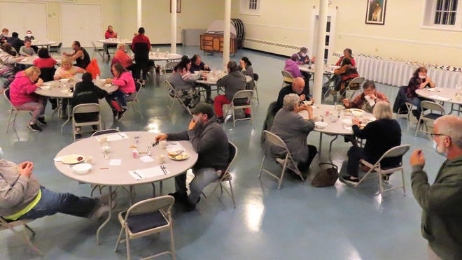 Deacon Rich Marino greets some of the guests at the St. Joseph's Table dinner at  St. Mary's Church.